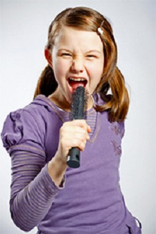Girl Singing Into Hairbrush