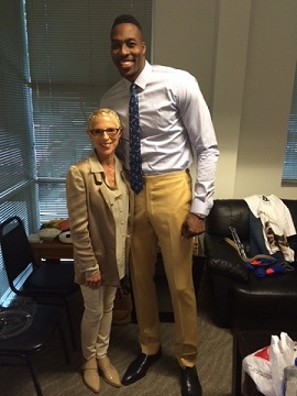 Irene with very tall NBA star Dwight Howard